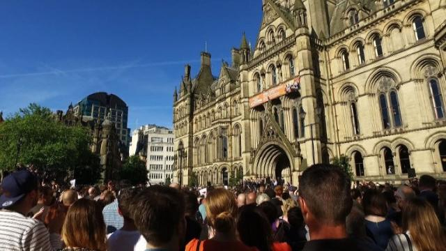 Chants of 'Manchester! Manchester!' ring out as thousands gather for a multi-faith vigil in the city centre to remember the victims of the deadly suicide attack claimed by the Islamic State group. Video provided by AFP