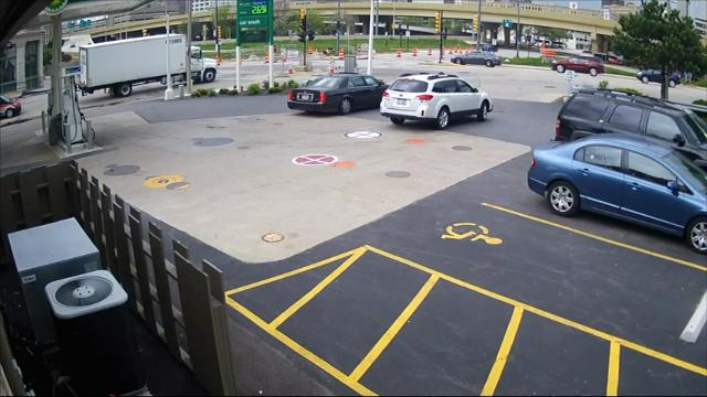 A Wisconsin woman pumping gas near downtown Milwaukee stopped a thief from stealing her SUV by jumping on its hood and clinging to the windshield wipers as the man tried to drive away in her vehicle. (May 25)
