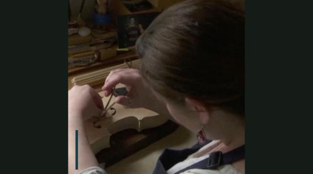 She puts special notes inside violins to honor fallen vets