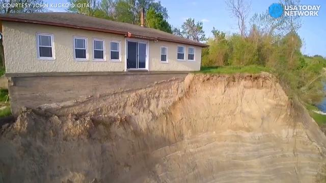 A family in Sodus Point, New York was forced to move out of their home after Lake Ontario erosion completely wiped out their backyard.