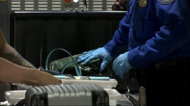 Travelers at some U.S. airports are being asked to place electronic devices that are larger than a cellphone in separate bins so they can be examined more closely.  TSA is testing the procedures at 10 airports, including Detroit Metropolitan. (May 25)