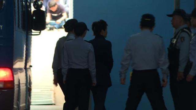 South Korea's ousted president Park Geun-Hye arrives at court in Seoul to go on trial over the massive corruption scandal that led to her downfall. Video provided by AFP