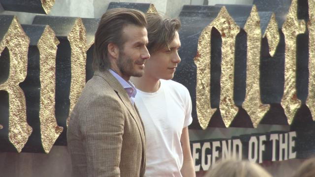 "Brooklyn Beckham, 18, was his dad's plus one at the premiere of ""King Arthur"" and the handsome duo was hard to miss."