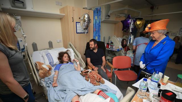 Queen Elizabeth visited with some of the young victims and their parents Thursday. Video provided by Newsy