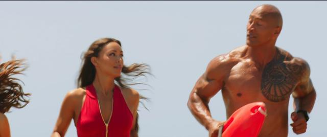 Zac Efron and Dwayne Johnson star in a new take on the classic lifeguard drama where the two uncover criminal activity that threatens their beach.