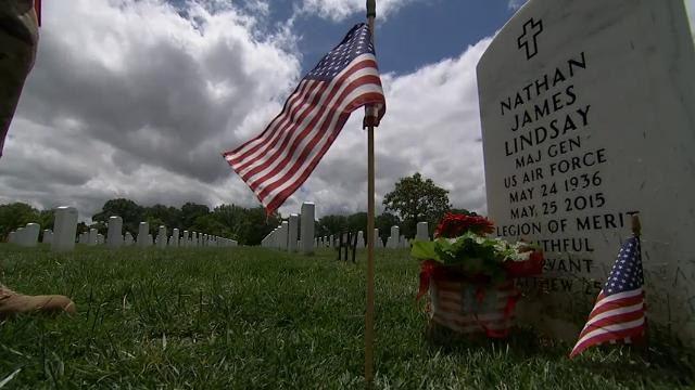 Members of the 3rd U.S. Infantry Regiment placed more than 280,000 small flags at the headstones of those buried at Arlington National Cemetery Thursday to mark the Memorial Day weekend. The tradition, known as 'flags in,' began in 1948. (May 25)