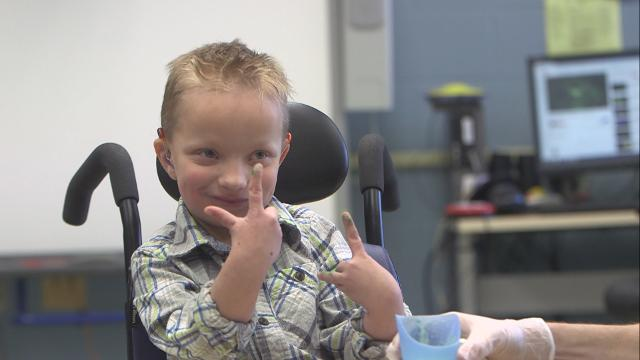 7-year-old faces health challenges but still makes everyone smile