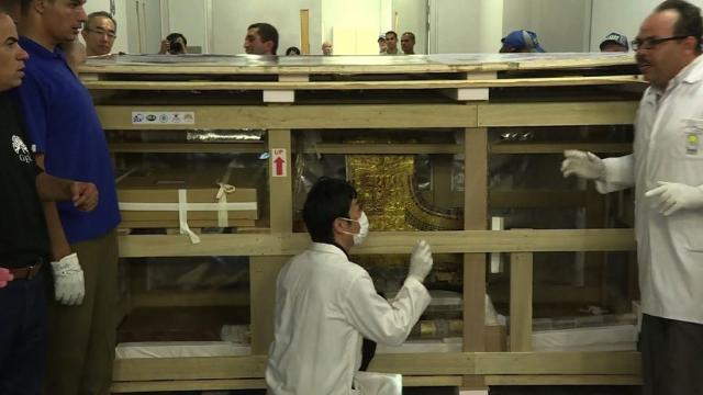 The first of the many wondrous artefacts found in Egyptian boy king Tutankhamun's tomb are transported carefully through Cairo's streets to their new home near the Giza Pyramids. Video provided by AFP