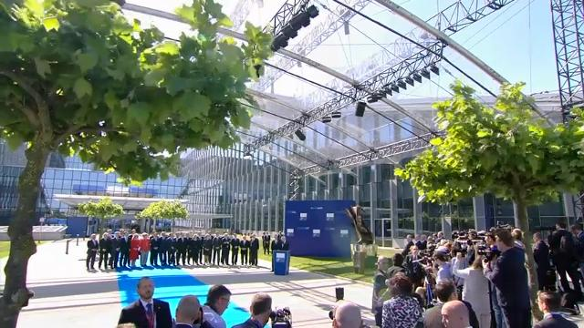President Donald Trump told members of the NATO alliance in Brussels Thursday that they must pay their fair share on defense. (May 25)
