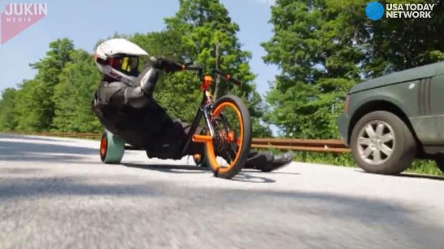 Watch grown men on trikes pop wheelies, pull stunts