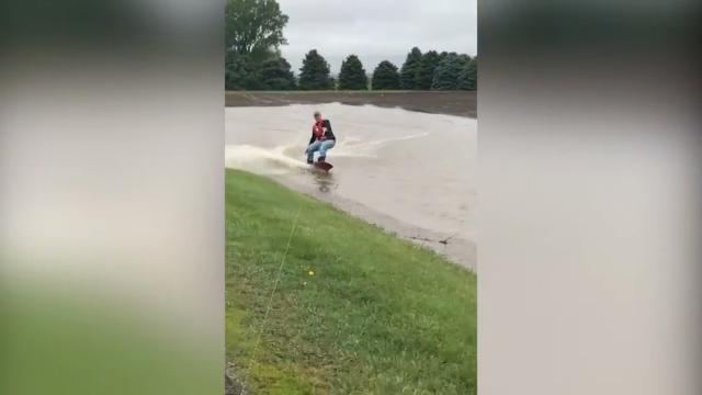 Nebraska farmer Quentin Connealy found a way this weekend to fill his spare time, wakeboarding along his flooded cornfield. (May 22)