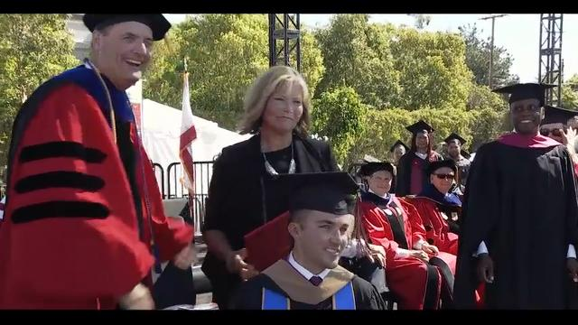 Chapman University in Southern California awarded an honorary degree to a woman who attended every class with her quadriplegic son and took his notes so he could complete his MBA. (May 23)