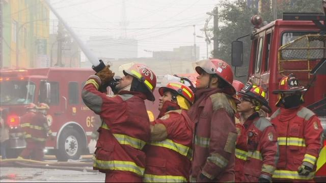 Firefighters continued to fight a structural fire on Friday that engulfed a hardware shop in Lima more than 20 hours earlier. (June 23)