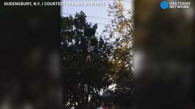 A 14-year-old girl fell from a Six Flags gondola ride in Queensbury, New York. Right before, good samaritans stood below her to shield her from harm.