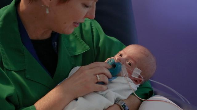 These NICU volunteers have one job: snuggle babies