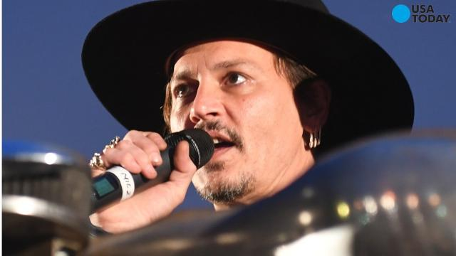 The audience cheered when Johnny Depp joked about assassinating President Donald Trump, while speaking at the Glastonbury Festival in England.