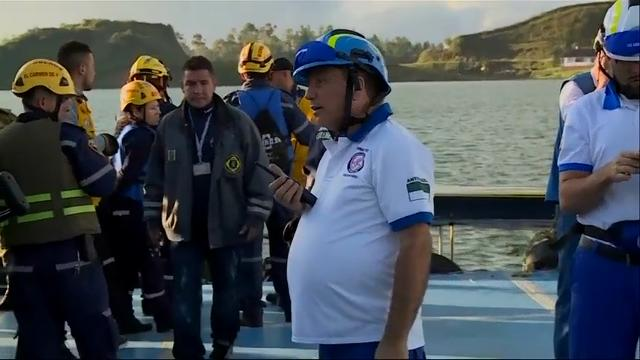 Scuba divers on Monday continued searching for bodies in a reservoir near the Colombian city of Medellin where a tourist boat packed with more than 150 passengers for the holiday weekend capsized, leaving at least six people dead and 15 missing. (June 26)