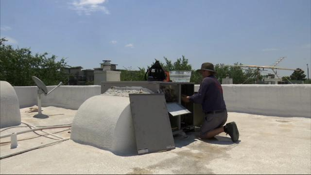 West heat wave means business for AC repairmen