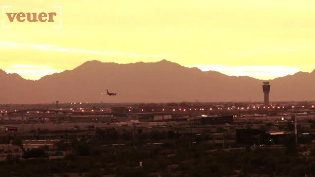 Nearly 50 American airlines flights out of Phoenix's international airport were canceled Tuesday. Josh King has the story (@abridgetoland).