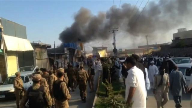 Twin blasts in NW Pakistan leave 13 dead, scores wounded.