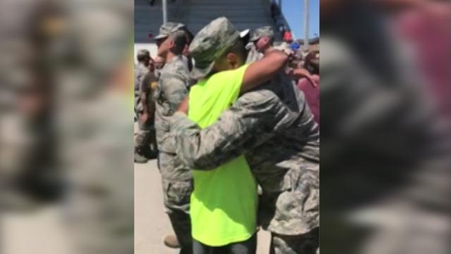 Dad gets out of wheelchair to give Airman son huge honor
