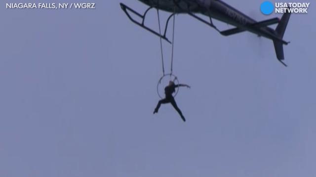 Daredevil Erendira Wallenda hangs from chopper by teeth